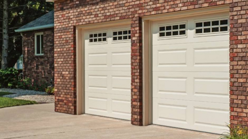 Garrett 39 s garage doors residential raised panel for Garage door repair cary nc